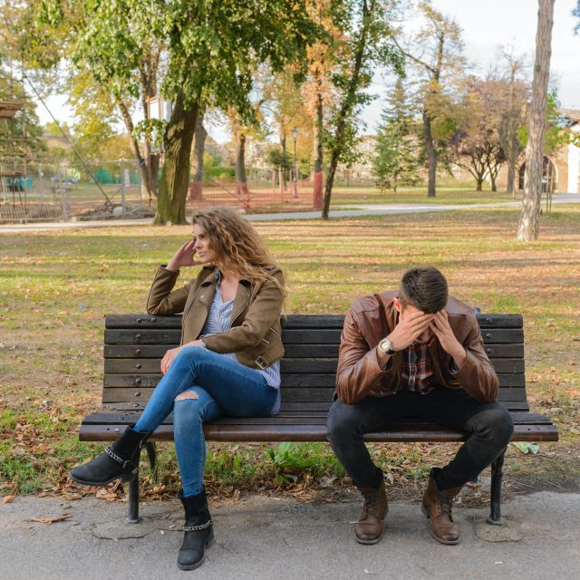Woman and Man Sitting on Wooden Bench